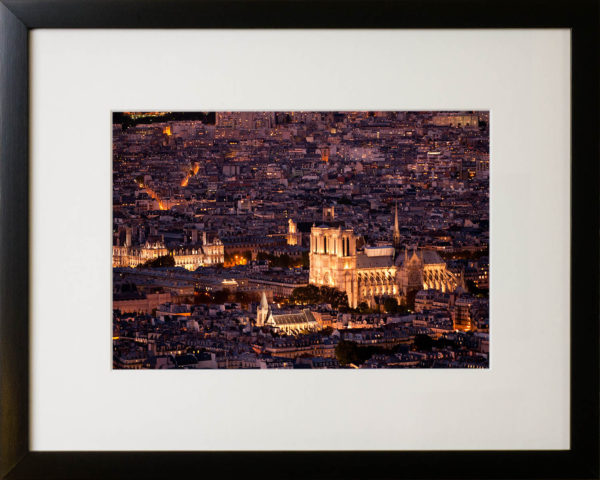 Notre Dame lit up at night, Paris, France. Framed Print.