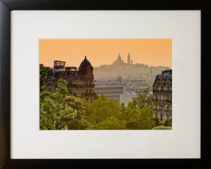 View across Paris from Buttes-Chaumont park to the Sacre-Coeur. Framed art print.