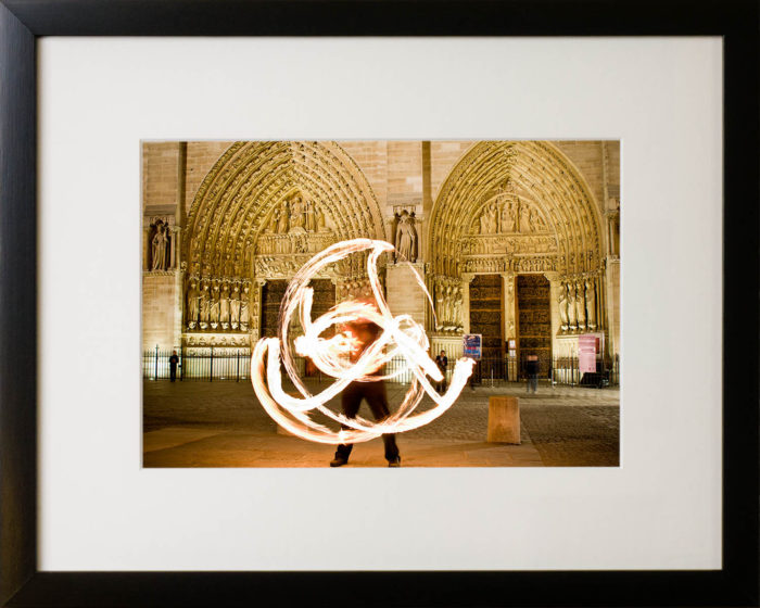 Fire performer, Notre Dame cathedral, Paris. Framed art print.