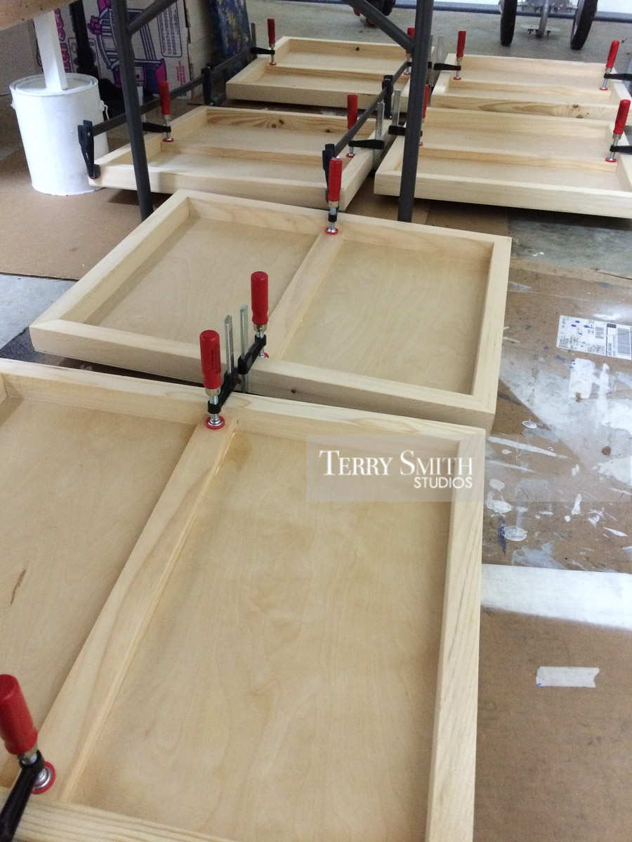Adding center support bracing to wooden panels. July 2016.