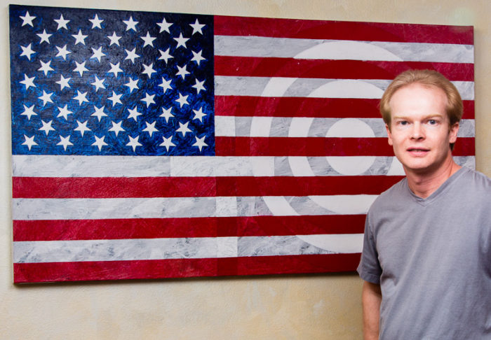 Artist Terry Smith with Born in the U.S.A. painting, 2015