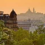 View across Paris from Buttes-Chaumont park to the Sacre-Coeur