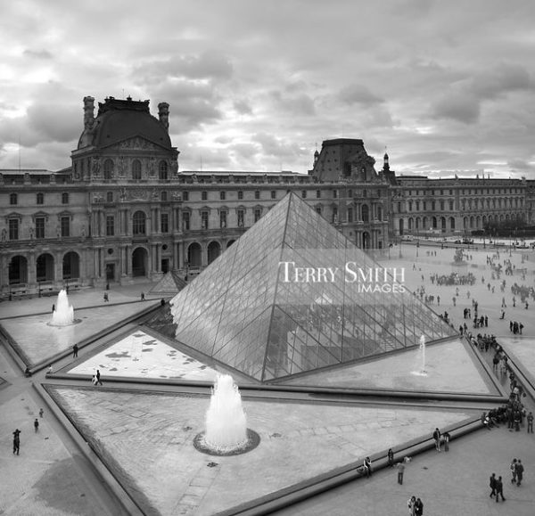 Courtyard and glass pyramid of the Louvre Museum in Paris, France.