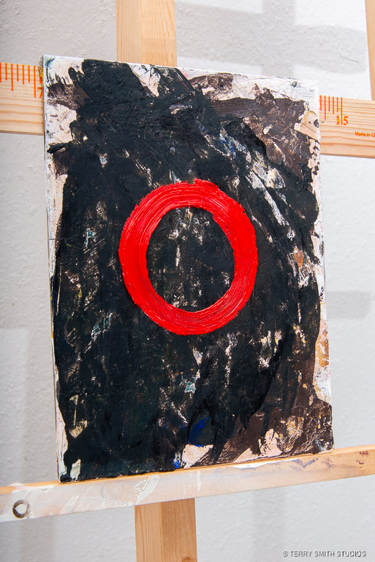 """Side view of Red Circle, 2018. Oil on canvas panel. 9"""" x 7""""."""